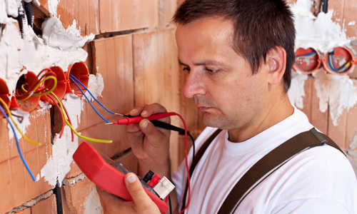 Electrician repairing an installation in a house